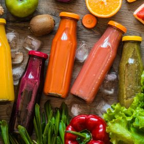 Detox diet. Healthy eating. Different colorful fresh juices, vegetables and fruits.